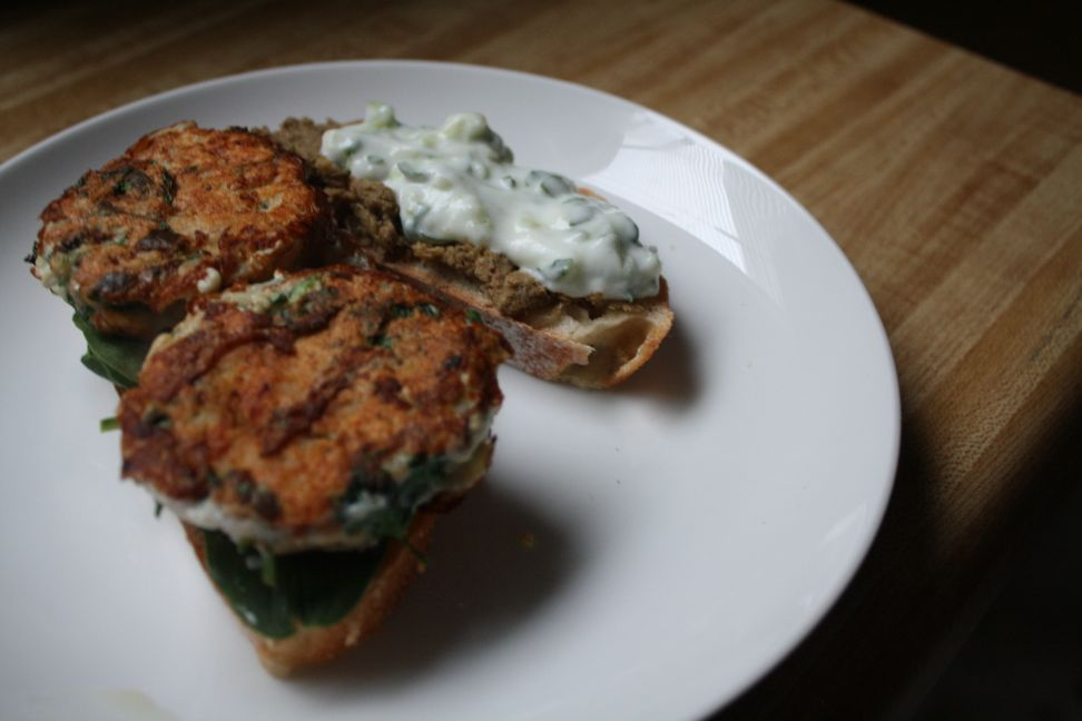 fish burger with lentil dip and cucumber yogurt