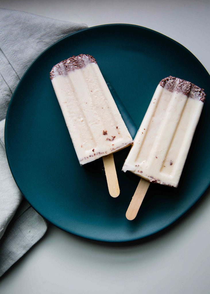 Infusing fresh herbs into cream is what makes these Mint Basil Chip Popsicles unforgettable