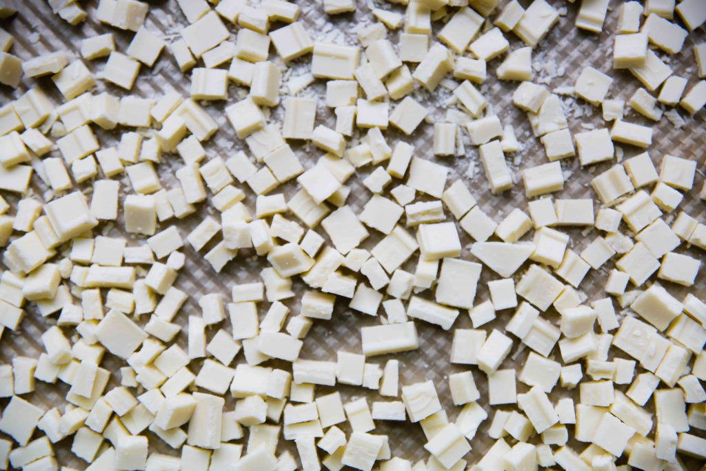 Have you ever tried roasting white chocolate? One key is low heat and then checking for color.