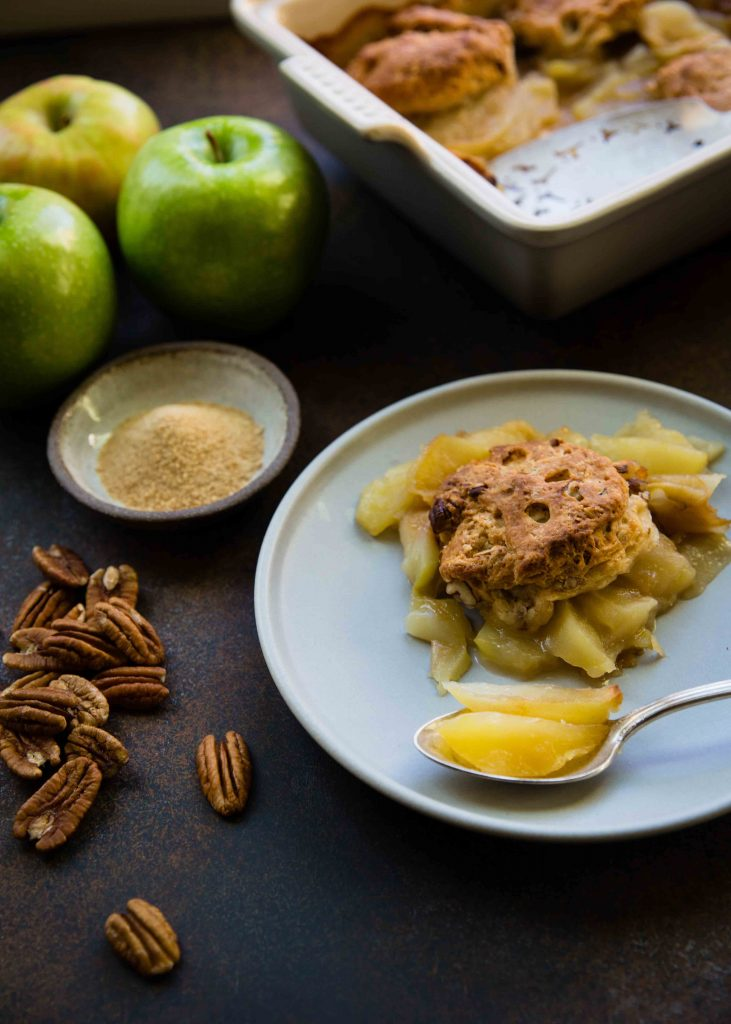 Maple sugar and spice and everything nice (like apples and pecans). Making an Apple Maple Pecan cobbler is an easy dessert to bake for a warming dessert.
