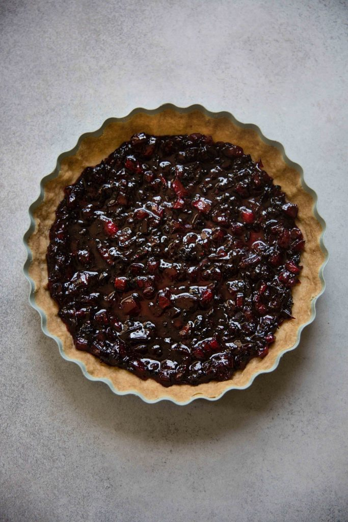Yogurt Jam Tart is a great way to make an easy dessert of either homemade jam or use storebought and a yogurt custard.