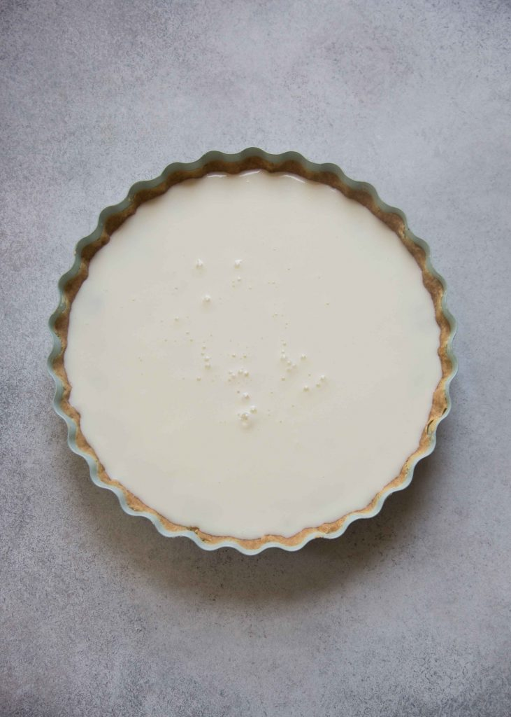 The yogurt layer is fairly easy to make for the yogurt jam tart. Use agar agar to gel the yogurt for a stiff set.