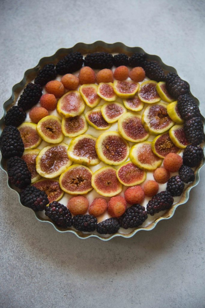 Fresh fruit tiled on top makes this yogurt jam tart a stunning dessert that's different each time.
